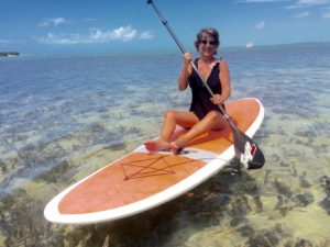 Mom sitting on a paddleboard